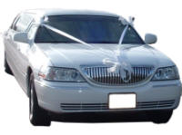 Cars for Stars (Southend) - Wedding Limo. White Lincoln stretched wedding limousine with white ribbons